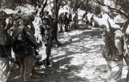 Troop of No 2 Commando form up in an olive grove for an attack at Spilje